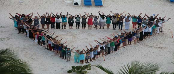 Conference attendees salute the World YWCA triangle.
