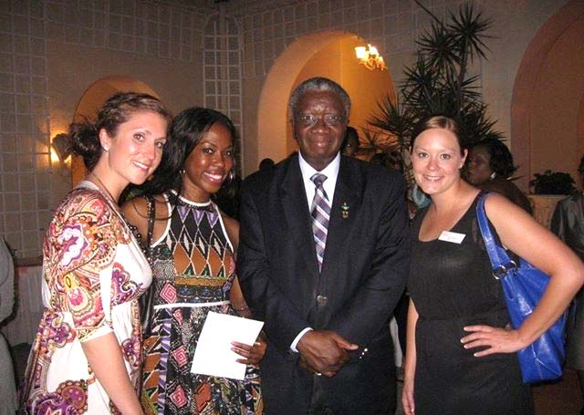 YWCA USA young women with Prime Minister Freundel Stuart (from left) Jenna Lodge Foster, Natalia Wilson, and Kyla Stone.
